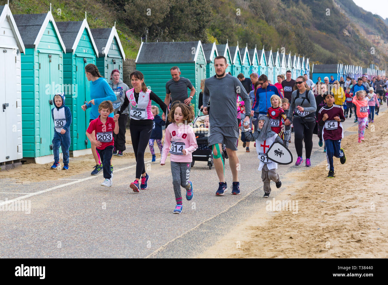 Bournemouth, Dorset, UK. 7th April 2019. Runners take part in the Bournemouth Bay Run on the theme of fun fairy-tale, which provides the option of a Half Marathon, 10k Run, 5k Run and 1k Kids Fun Run along Bournemouth's sea front. Participants get amazing views along the coast as they take part.Participants run to raise vital funds for the British Heart Foundation charity to fight against heart disease. A dry day with hazy sunshine. Credit: Carolyn Jenkins/Alamy Live News - Stock Image