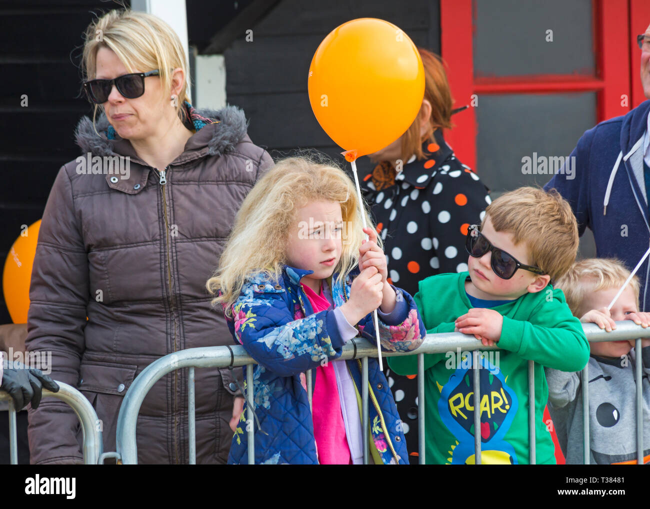 Bournemouth, Dorset, UK. 7th April 2019. Spectators provide support at Bournemouth Bay Run along Bournemouth's sea front. Participants run to raise vital funds for the British Heart Foundation charity to fight against heart disease. A dry day with hazy sunshine. Credit: Carolyn Jenkins/Alamy Live News - Stock Image