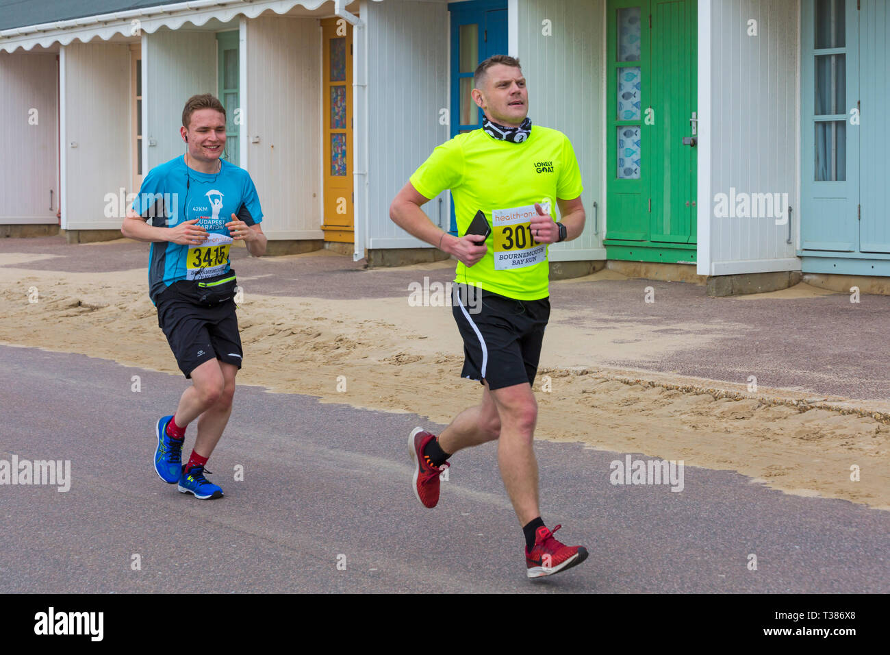 Bournemouth, Dorset, UK. 7th April 2019. Runners take part in the Bournemouth Bay Run on the theme of fun fairy-tale along Bournemouth's sea front – half marathon runners. Participants run to raise vital funds for the British Heart Foundation charity to fight against heart disease. A dry day with hazy sunshine.  Credit: Carolyn Jenkins/Alamy Live News - Stock Image