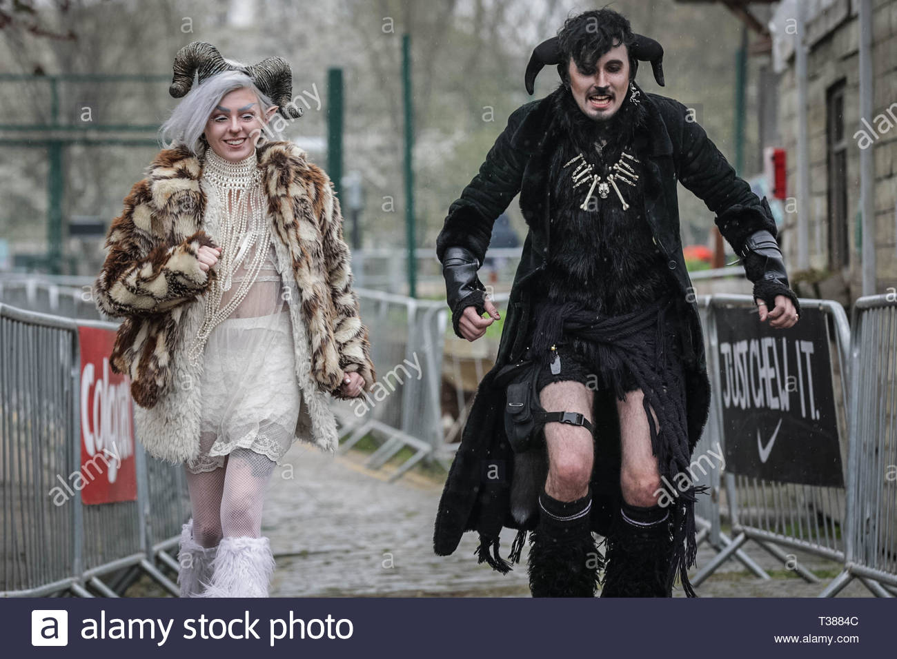 London, UK. 7th April 2019. A suitably dressed couple have fun at the 11th Annual Oxford vs Cambridge Goat Race at Spitalfields City Farm. Credit: Guy Corbishley/Alamy Live News - Stock Image