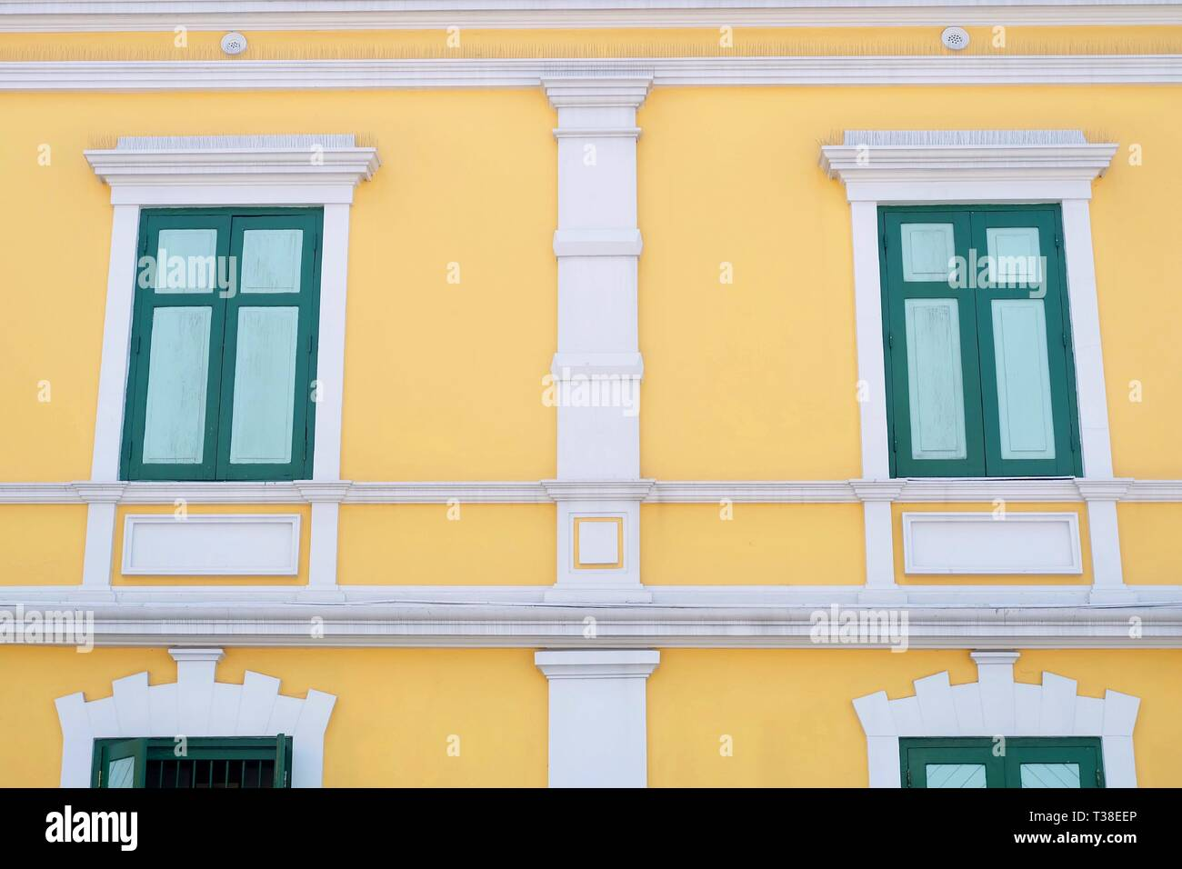 Yellow Building with Green Windows of The Ministry of Defence, The Ministry Controls and Manages The Royal Thai Armed Forces to Maintain National Secu - Stock Image