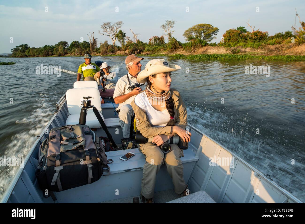 Tourists enjoying the Wetlands, Paraguay River, Pantanal, Brazil - Stock Image