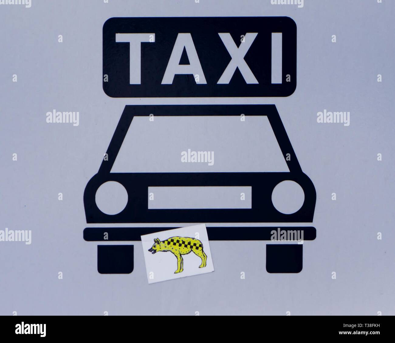 Taxi table with hyena stickers in budapest stock image