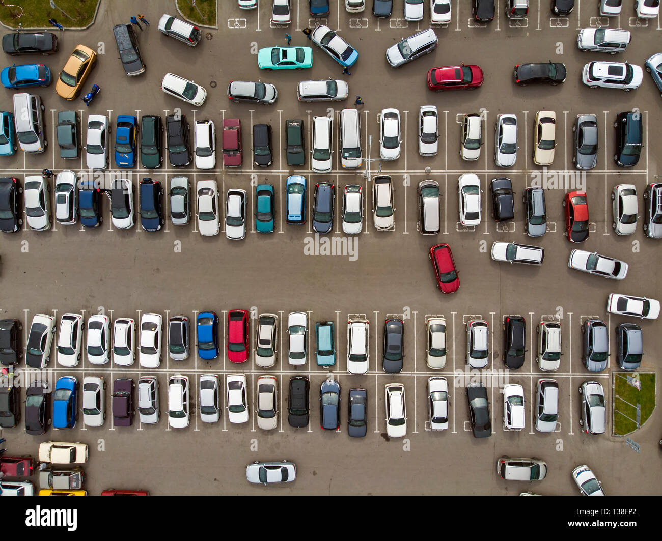 A view from above to the lines of parked cars. Heavy traffic in the parking lot. Searching for spaces in the busy car park. Cruising for parking in do - Stock Image