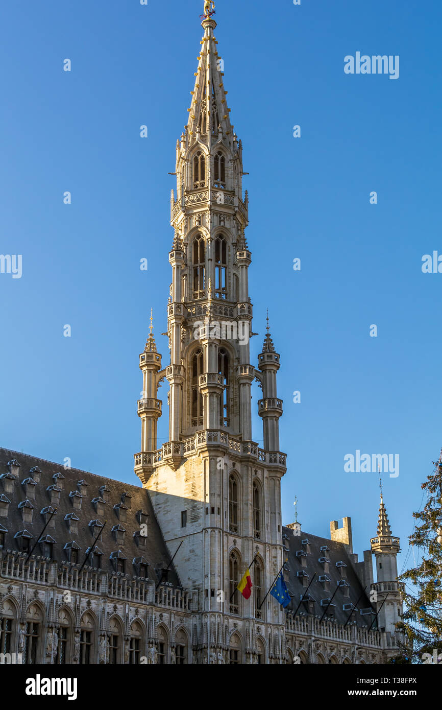 The tower of The Brussels Town Hall in Brabantine Gothic style with lavishly pinnacled octagonal openwork. - Stock Image