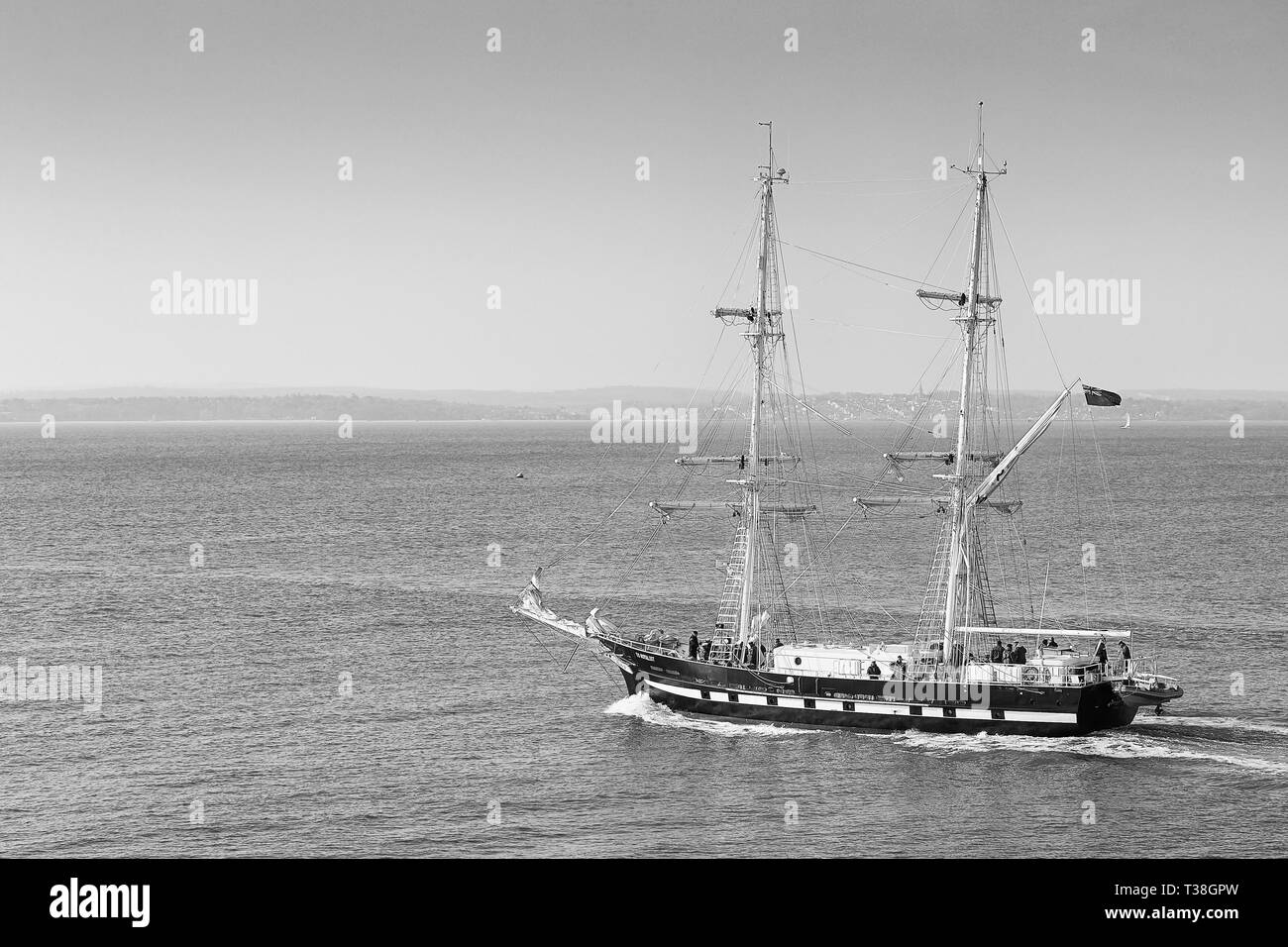 Black And White Photo Of The Tall Ship, TS ROYALIST, Underway, As She Leaves Portsmouth Harbour, UK. 01 April 2019. - Stock Image