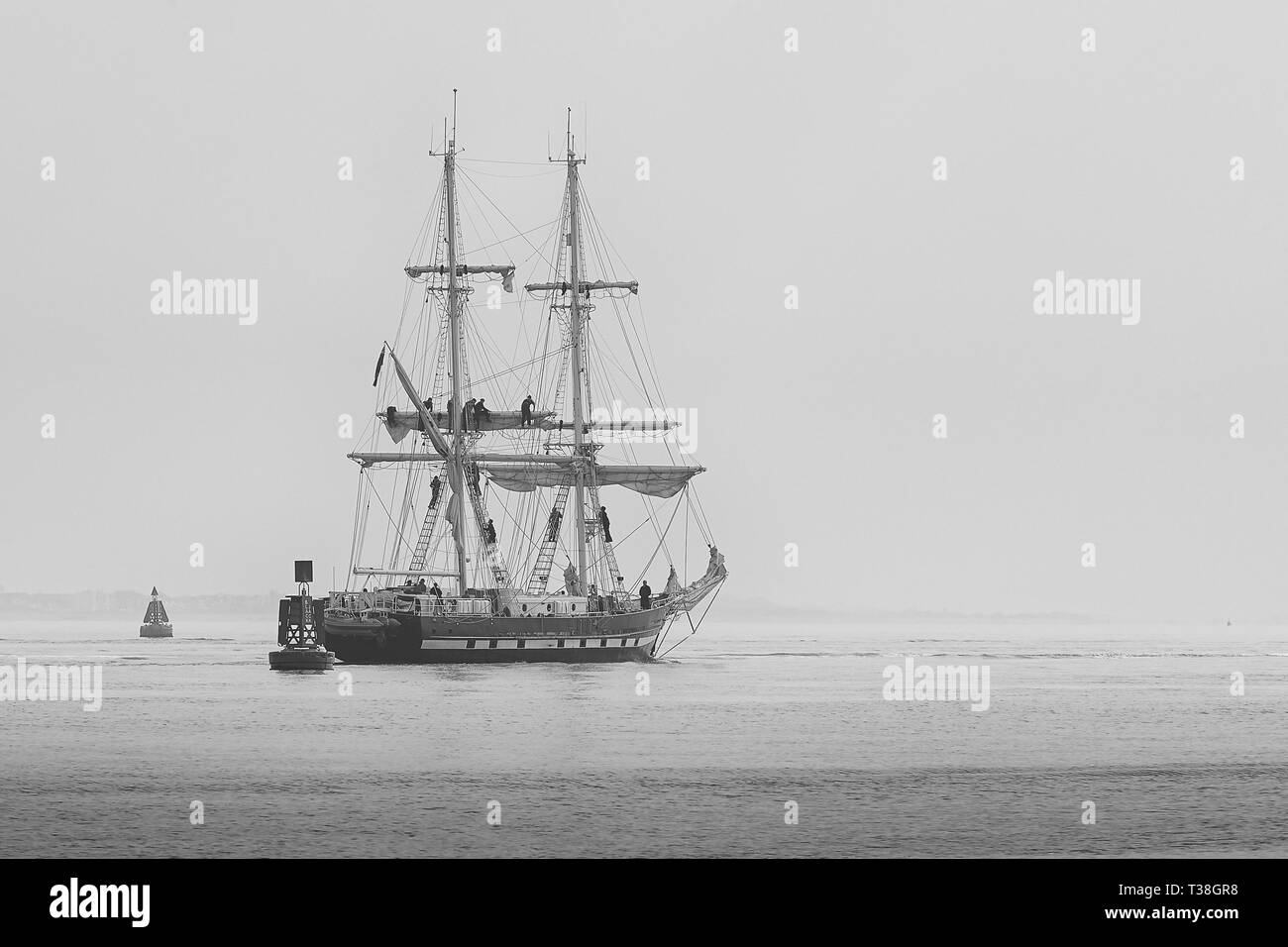 Black And White Image Of Sailors Setting Sail On The Training Ship, TS ROYALIST (Tall Ship), Departing The Port Of Southampton, 28 March 2019. - Stock Image