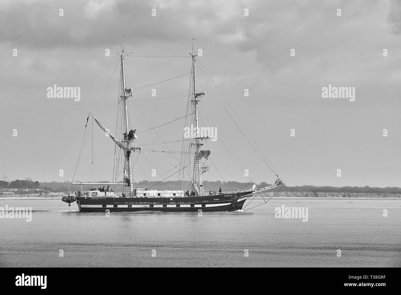 Black And White Photo Of Sailors Setting Sail On The Training Ship, TS ROYALIST (Tall Ship), Departing The Port Of Southampton, 28 March 2019. - Stock Image