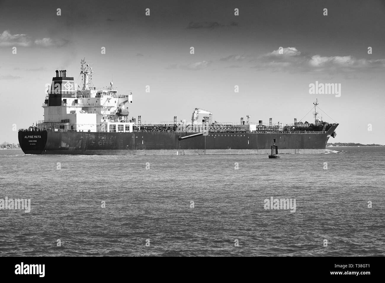 Black and White Photo Of The Chemical/Oil Products Tanker (Oil Tanker), ALPINE MAYA, Departs The Fawley ESSO Oil Refinery At The Port Of Southampton. - Stock Image