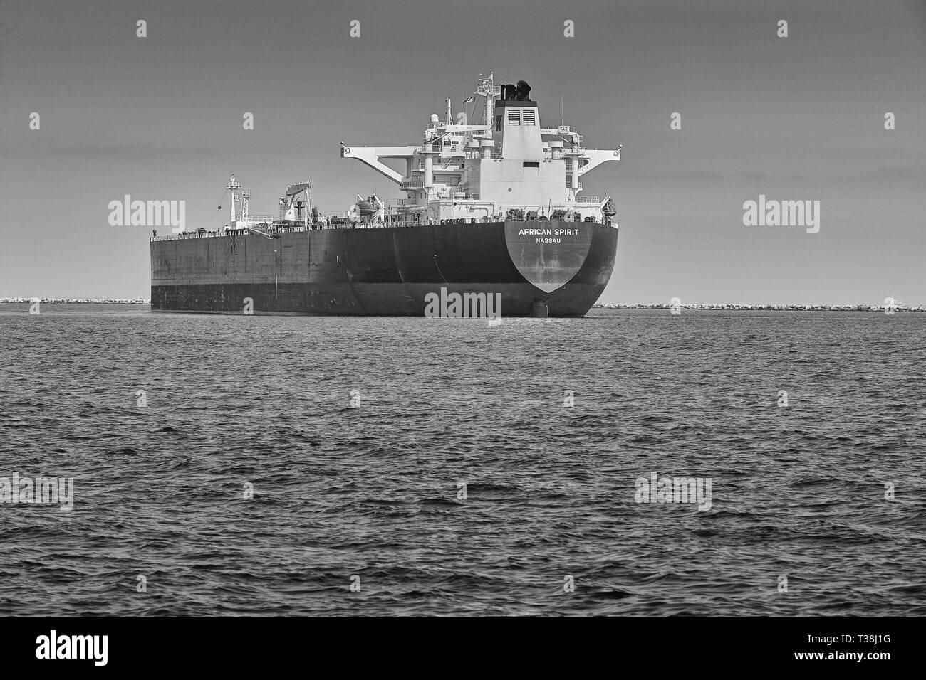 Black And White Image Of The Crude Oil Supertanker, African Spirit, Anchored In The Port of Long Beach, California. USA. - Stock Image