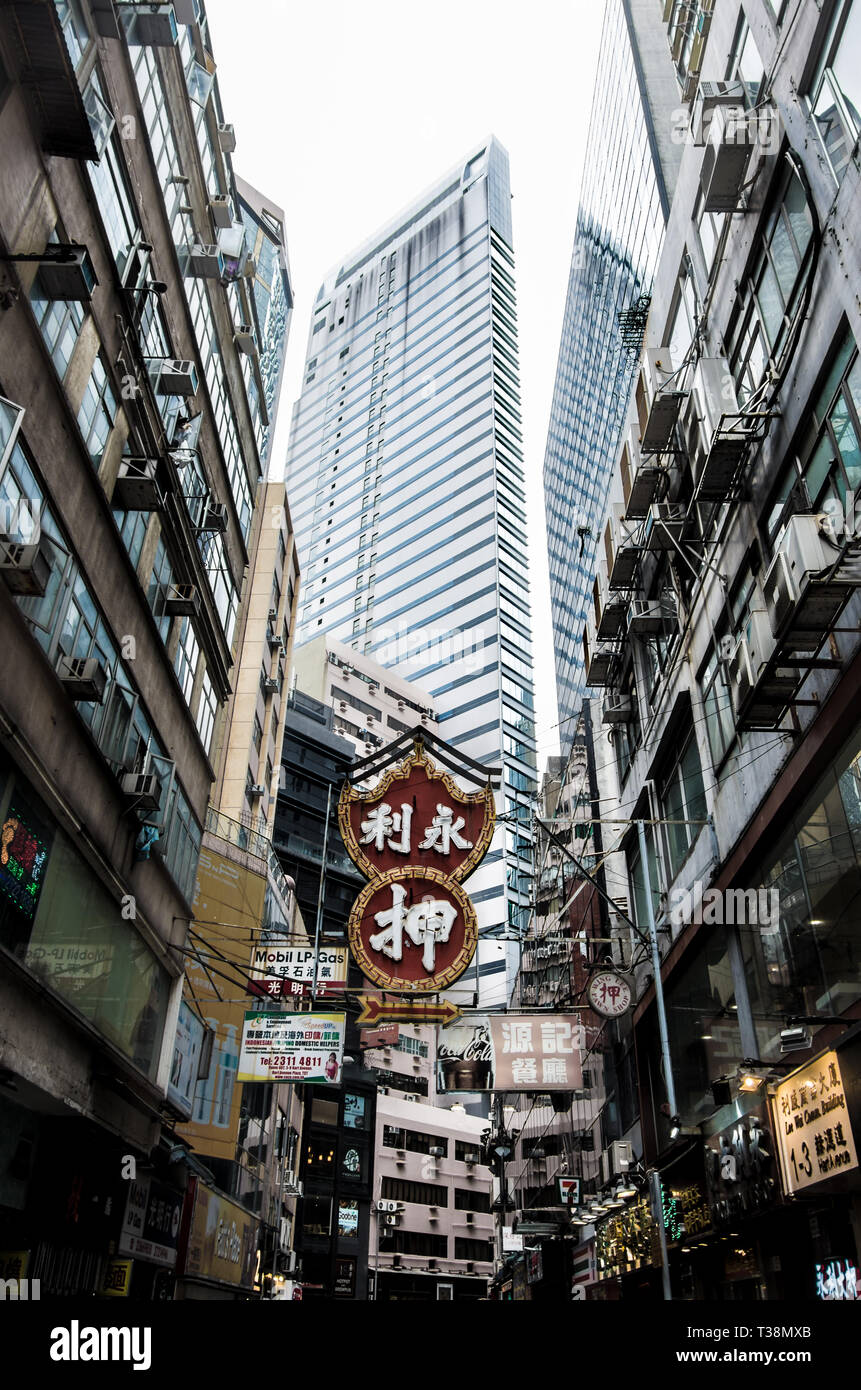 Hong Kong cityscape near Nathan Road, Old Buildings and new architecture, East Asia, Street signs, travel - Stock Image