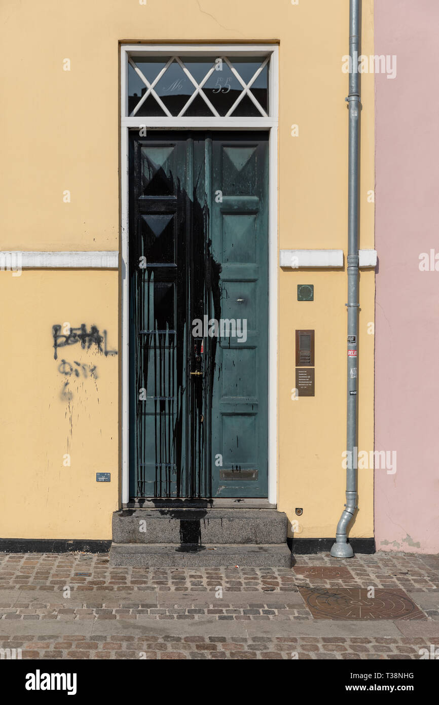 Vandalism; black paint thrown on front door of old house - Stock Image