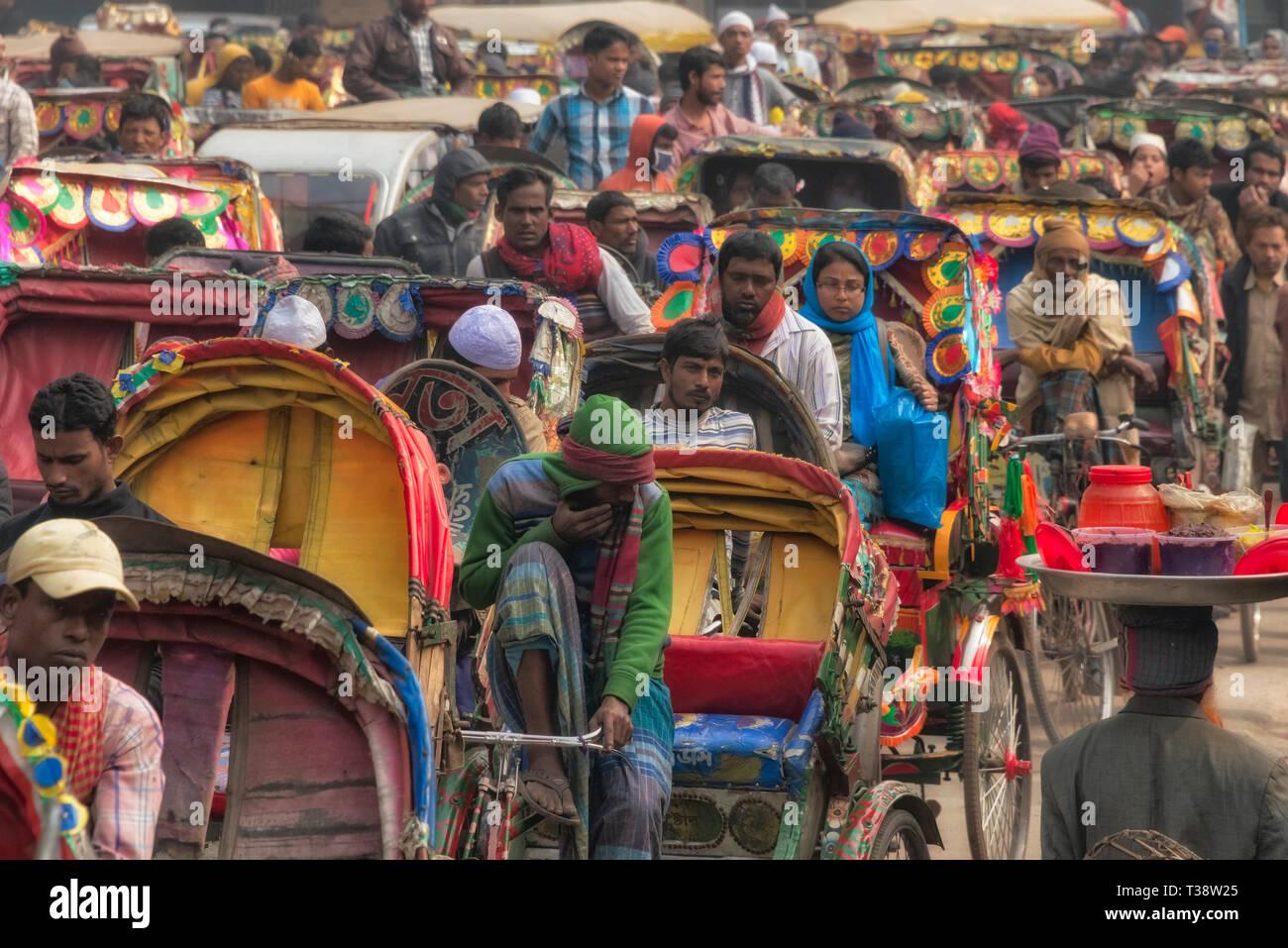 Rickshaws on the busy street, Dhaka, Bangladesh - Stock Image