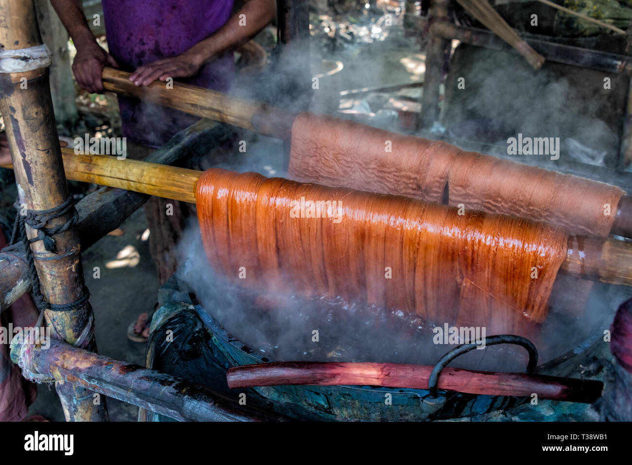 Traditional way of dying yarn in the traditional weaving village, Tangail district, Dhaka Division, Bangladesh - Stock Image