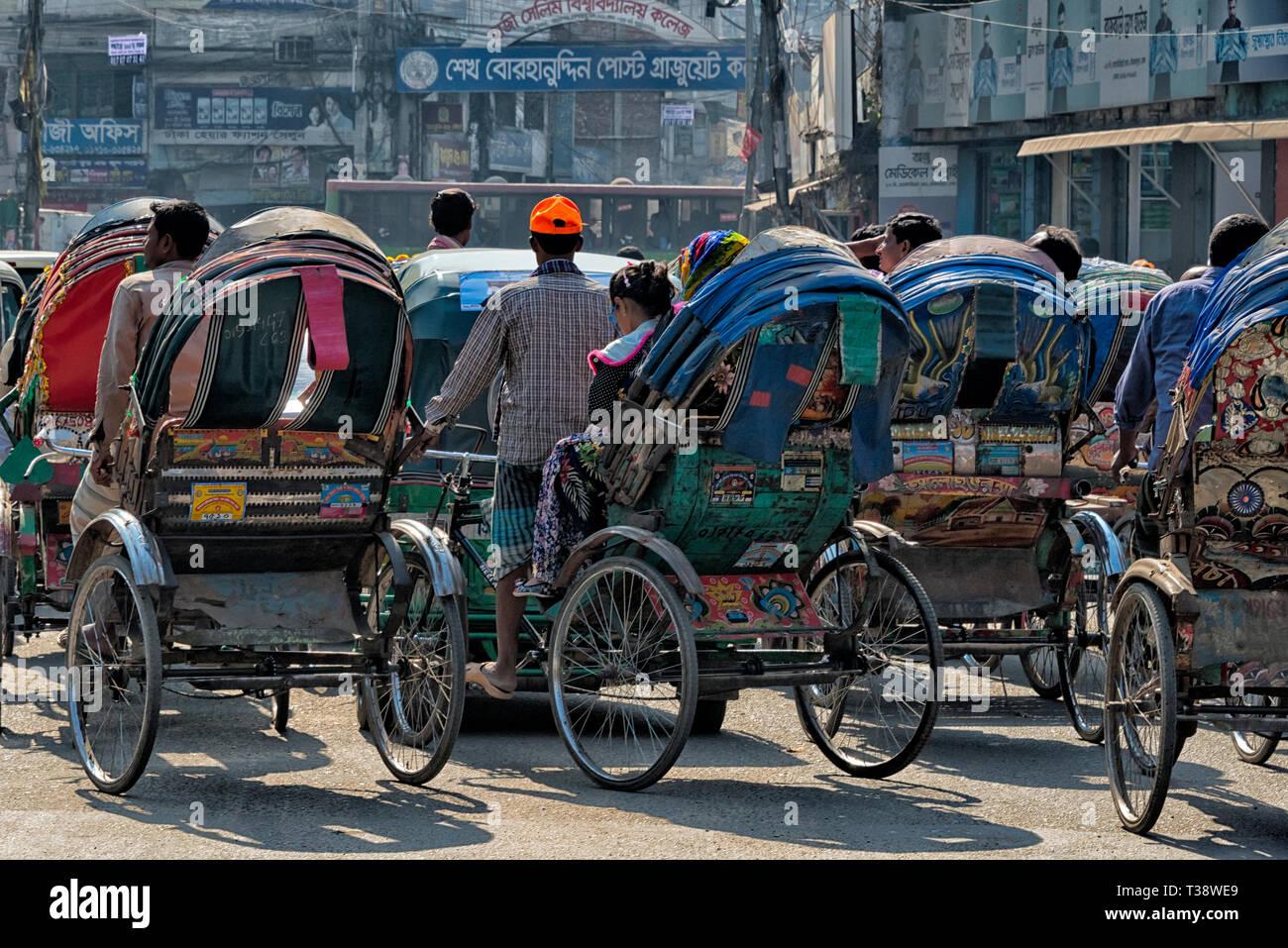 Rickshaws on the street, Dhaka, Bangladesh - Stock Image