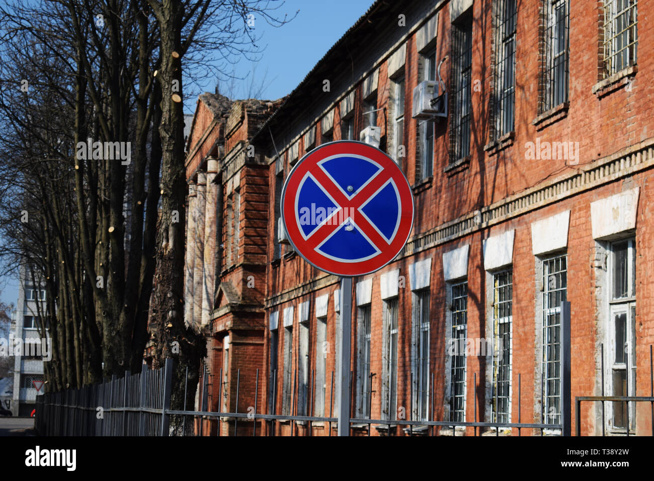Traffic sign No Stopping on a brick building background - Stock Image