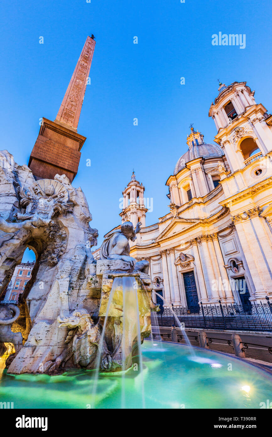 Rome, Italy. The fountain of the four Rivers with Egyptian obelisk at twilight, Piazza Navona. - Stock Image
