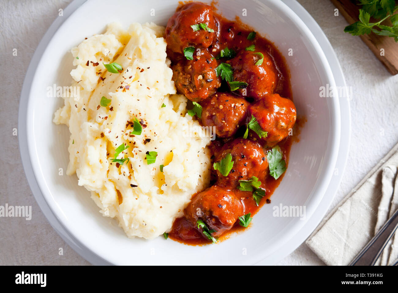 Bowl of homemade meatballs with mashed potatoes and tomato sauce - Stock Image