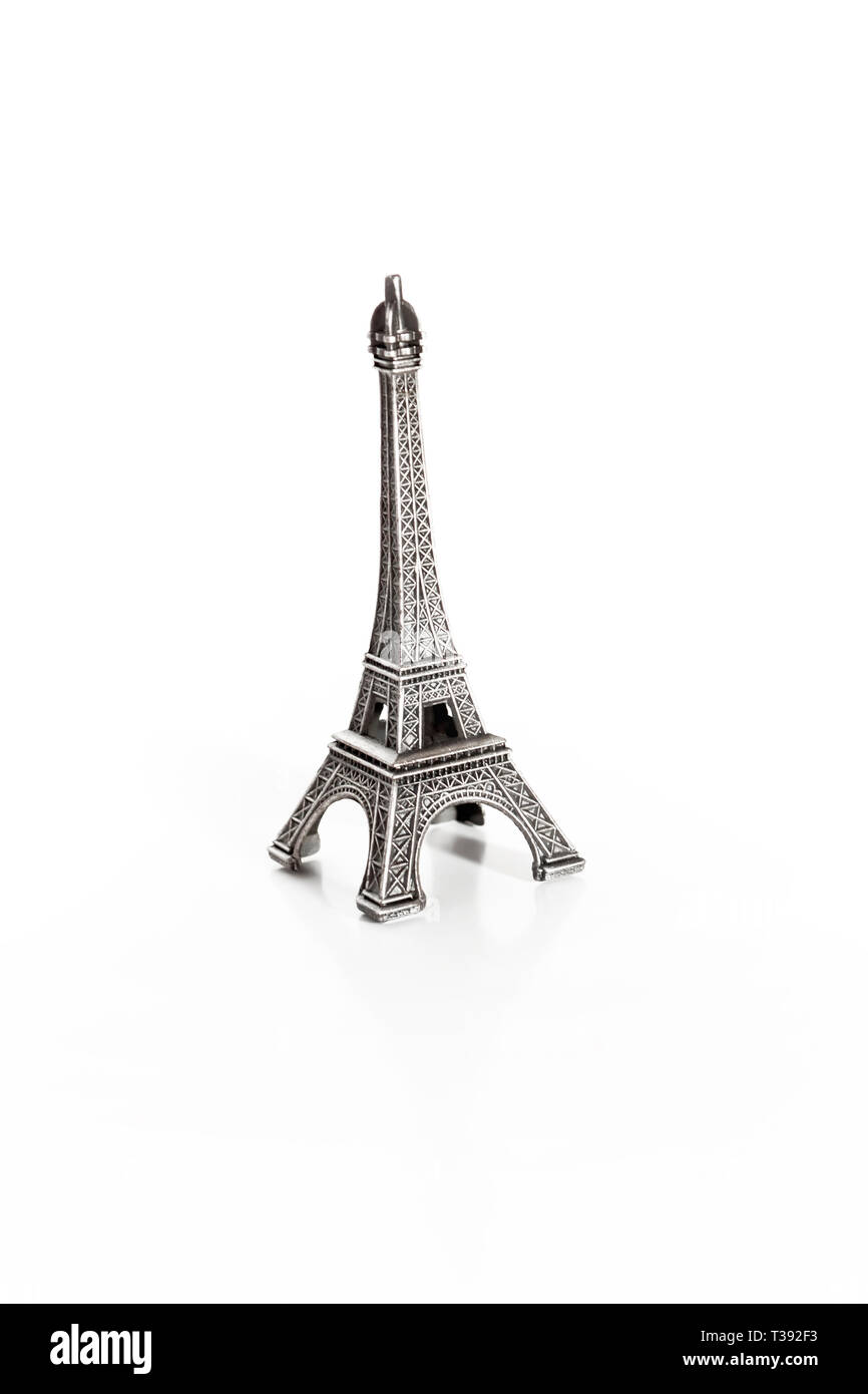 small copy of eiffel tower on white background Stock Photo