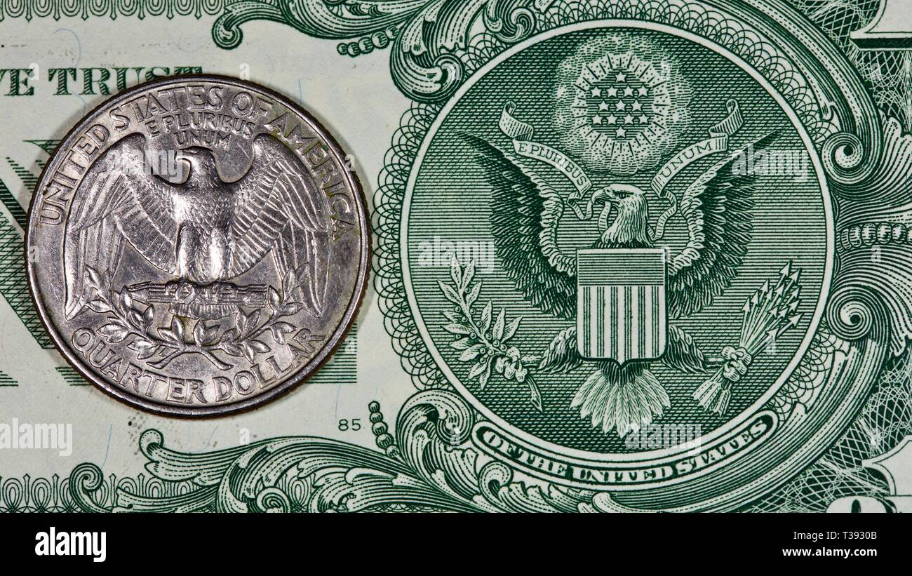 American quarter-dollar coin on a one dollar bill - Stock Image