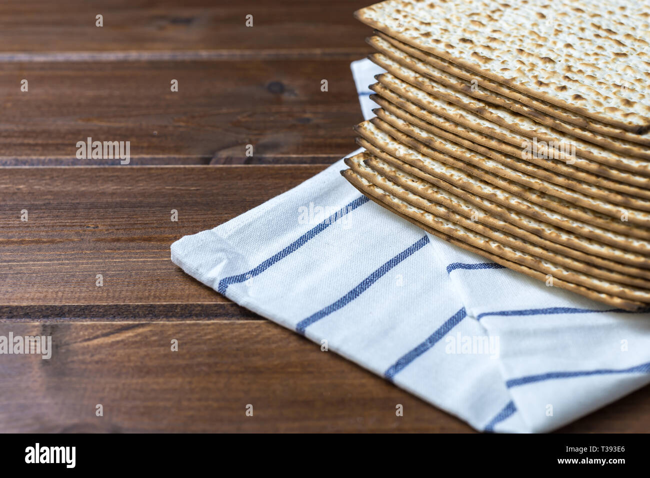 Stack of matzah or matza on a wooden table - Stock Image