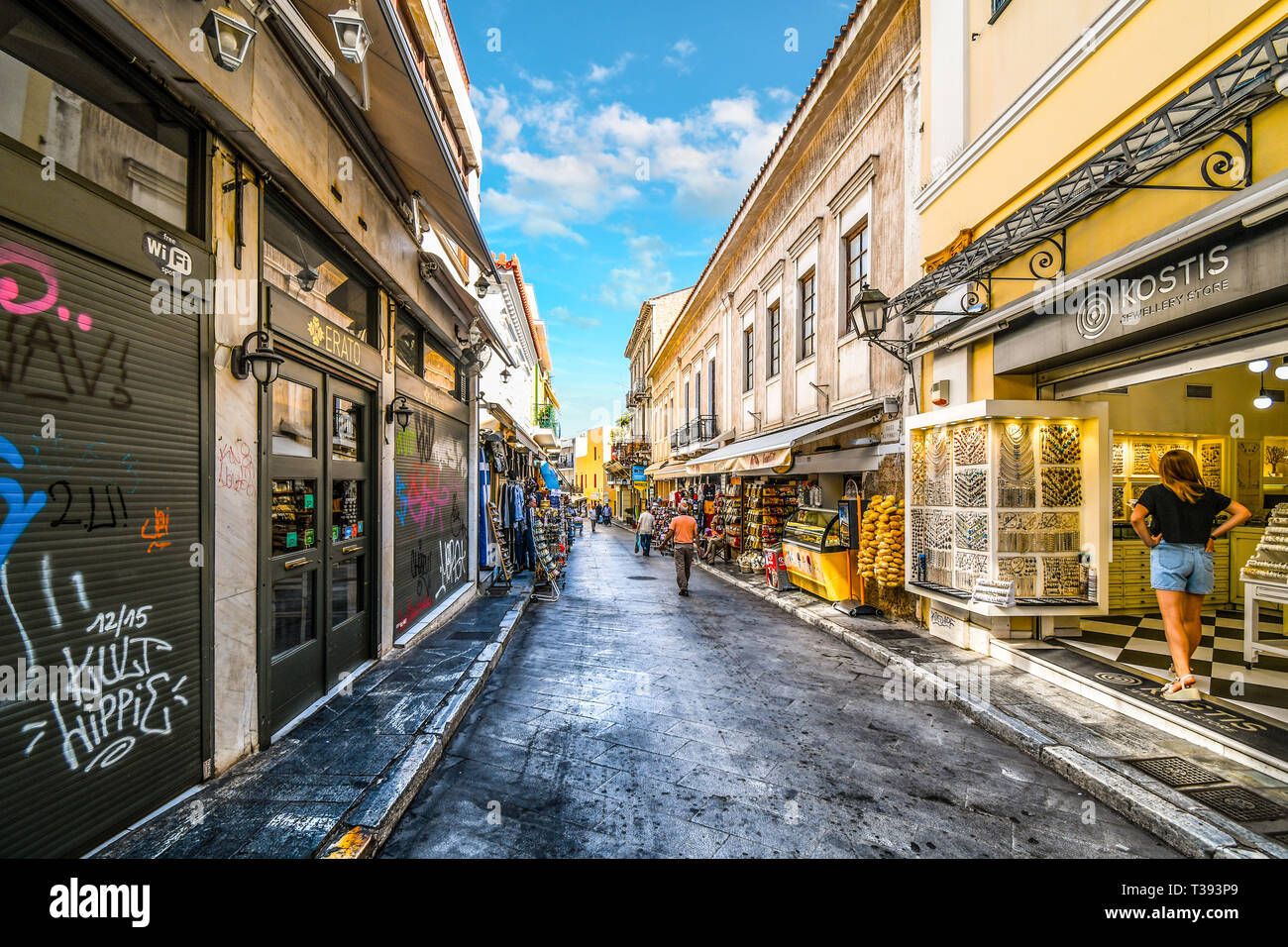 A typical touristy street and neighborhood in the Plaka District of Athens, Greece, with cafes, souvenirs and markets Stock Photo