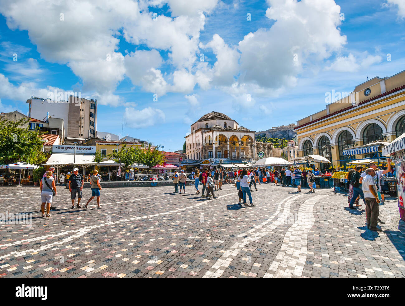 Local Greeks and tourists enjoy an afternoon shopping at Monastiraki Square near the base of Acropolis Hill on a summer day in Athens, Greece Stock Photo