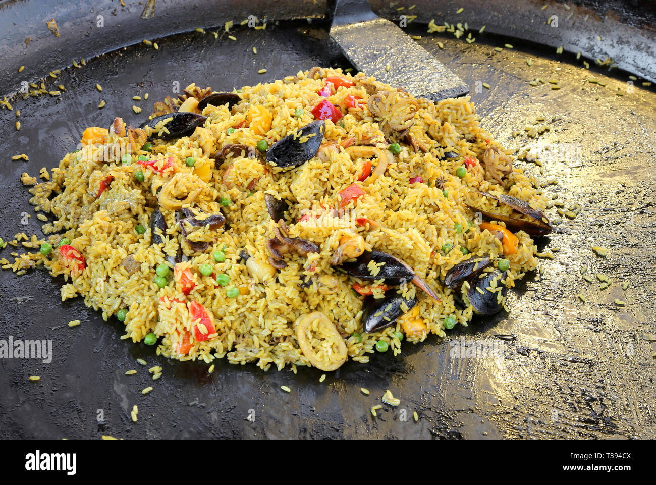 Spanish restaurant with tasty paella with rice and mussels and seafood on the large pan Stock Photo