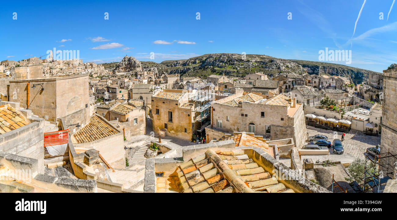 Panoramic shot of the steep cliffs and canyon sassi caves, the ancient Madonna de Idris rock church and the  city of Matera, Italy. - Stock Image