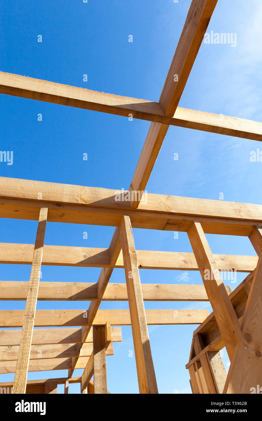 Sturdy Wooden House Construction Of Wooden Building Materials Construction Of A Frame House Against The Blue Sky Stock Photo Alamy