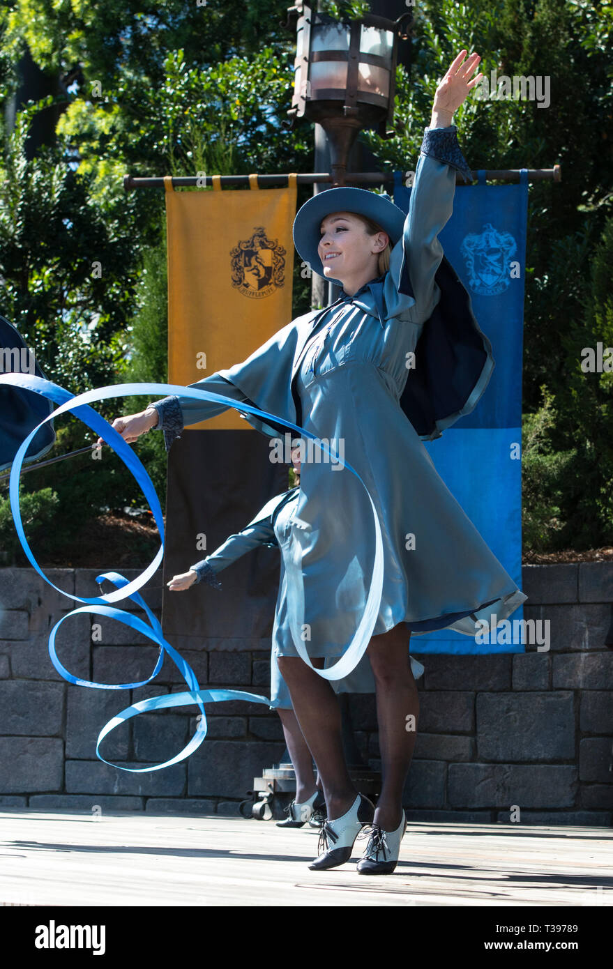 Beauxbaton ribbon dancer, on stage during live performance, with twirling blue ribbon, Wizarding World of Harry Potter, Orlando, Florida, USA. - Stock Image
