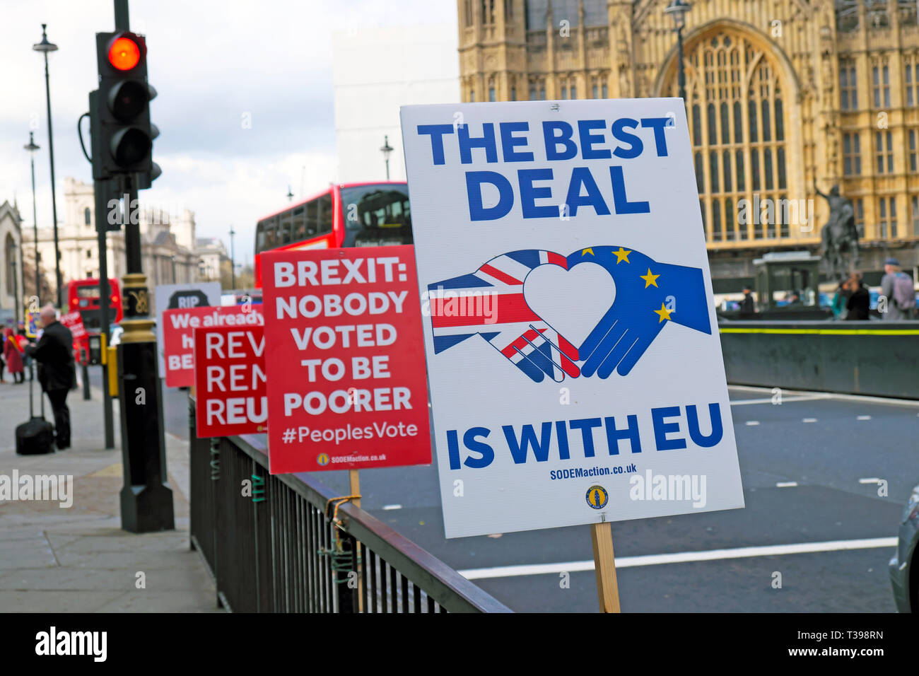 Brexit posters supporters to leave the EU and remainers outside the Houses of Parliament in Westminster, London England UK  4 April 2019  KATHY DEWITT Stock Photo
