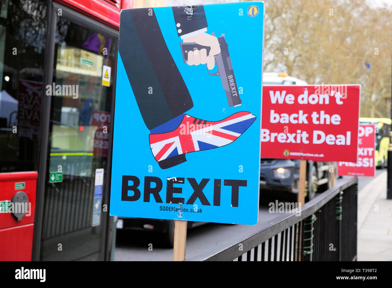 Anti-Brexit SODEM gun Union Jack shoe poster  'Shoot Yourself in the Foot'  outside Parliament in Westminster, London UK 4 April 2019  KATHY DEWITT - Stock Image