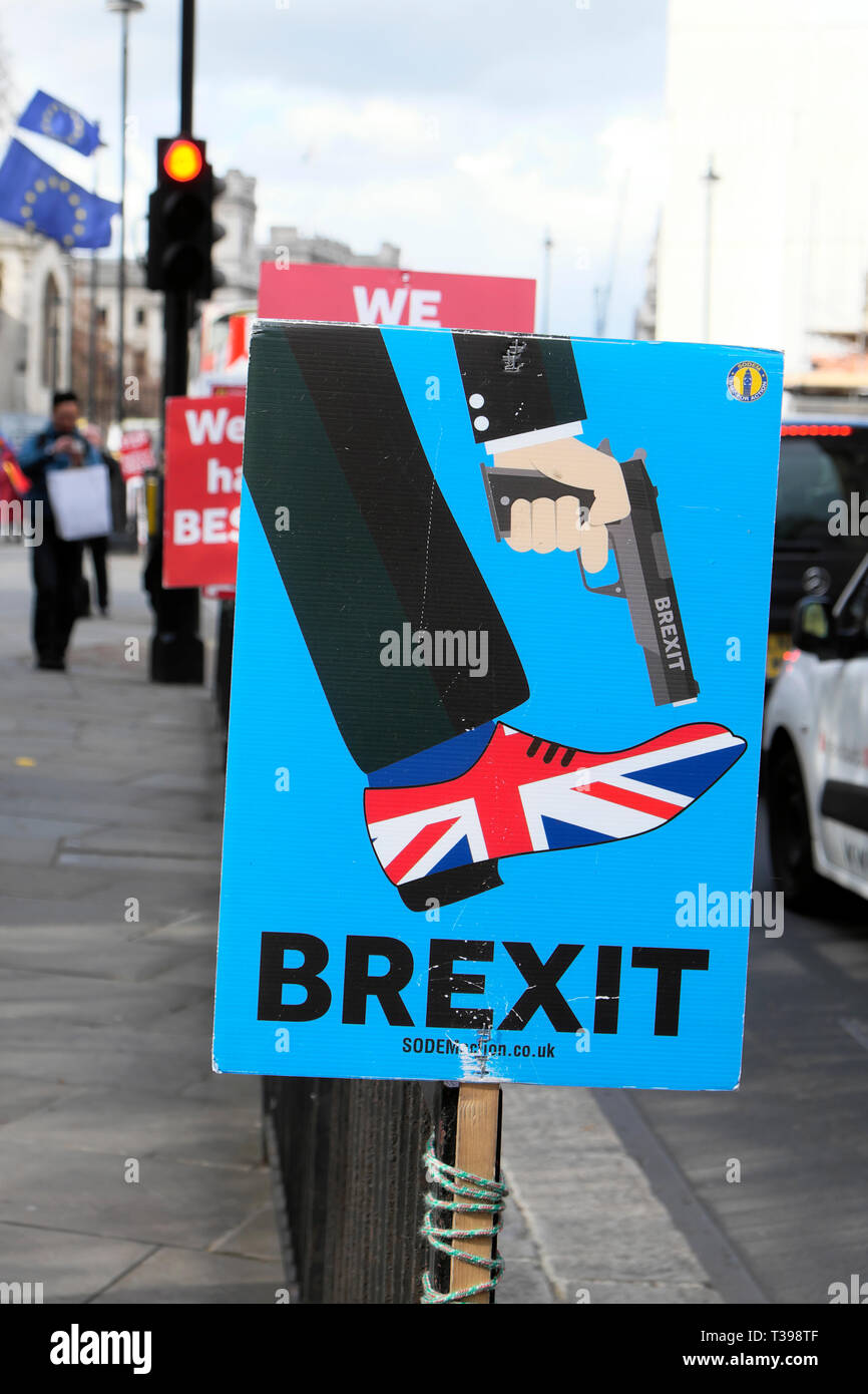 Brexit SODEM gun Union Jack shoe poster  'Shoot Yourself in the Foot'  outside Parliament in Westminster, London UK 4 April 2019  KATHY DEWITT - Stock Image