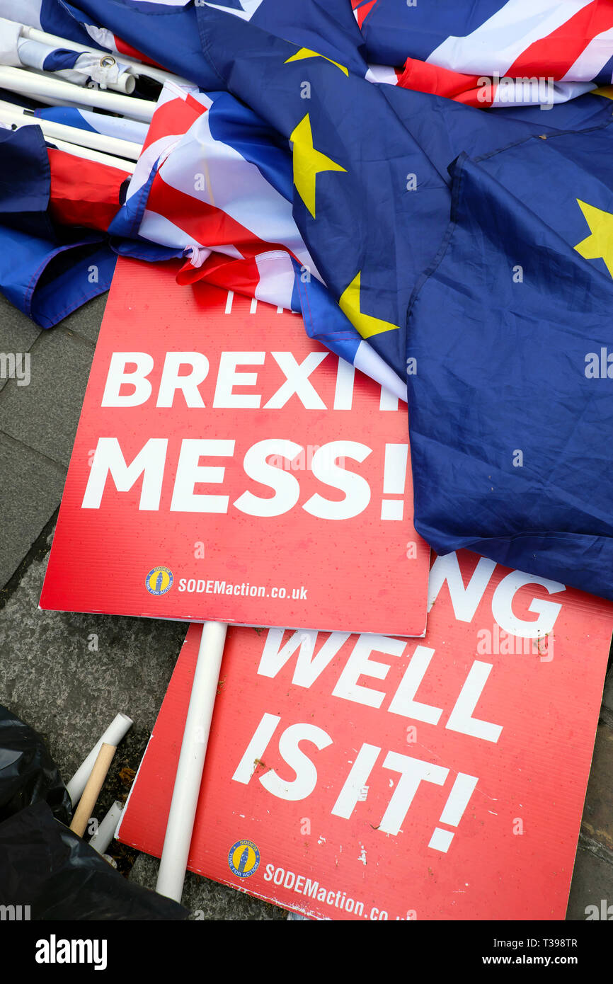 Brexit Mess Remainers placards and flags lying in the street outside the Houses of Parliament Westminster London England UK 4 April 2019  KATHY DEWITT - Stock Image