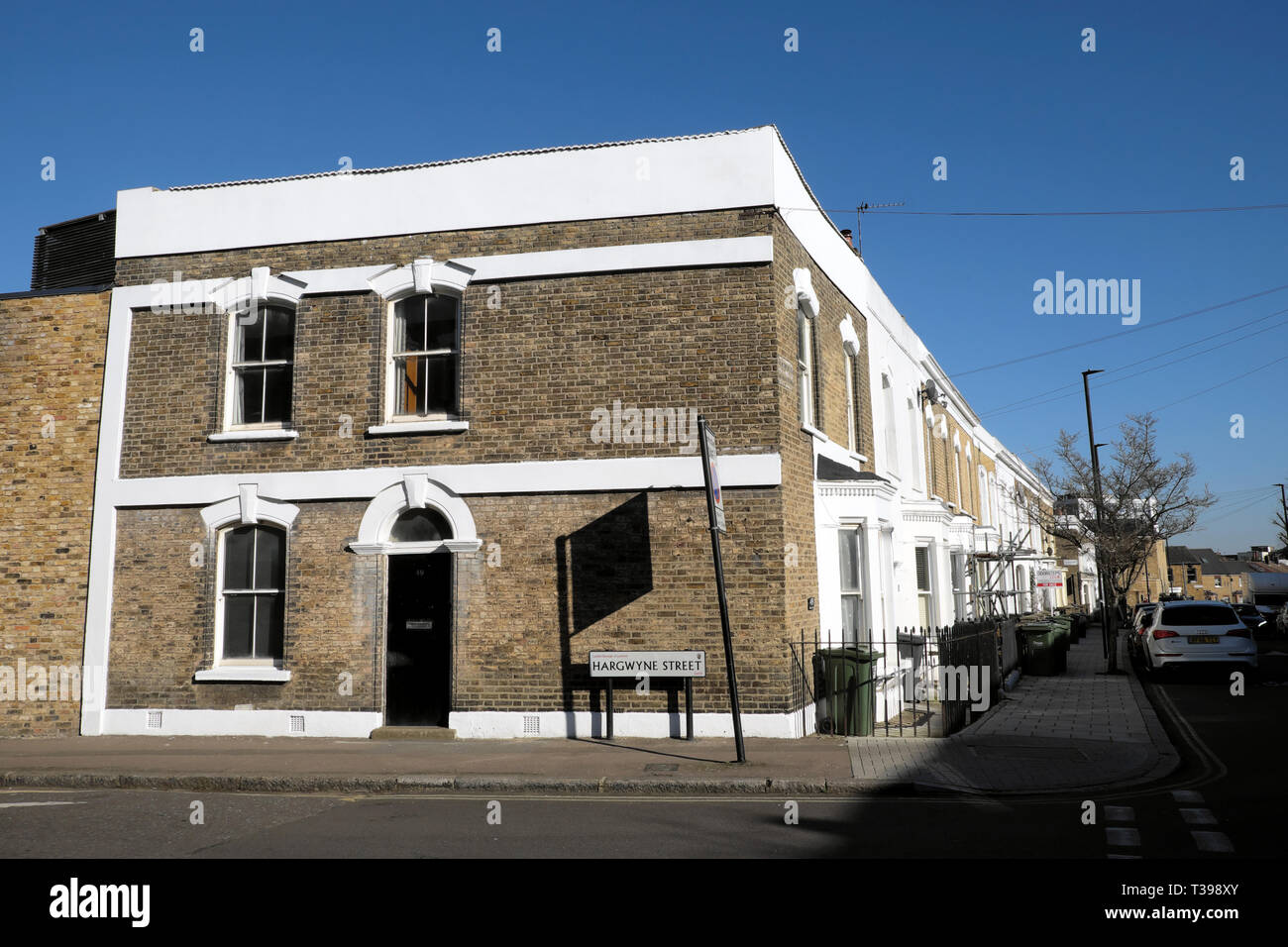House on the corner of Hargwyne Street at the end of a row of terraced housing on Pulross Road in Brixton, South London SW9 England UK  KATHY DEWITT - Stock Image