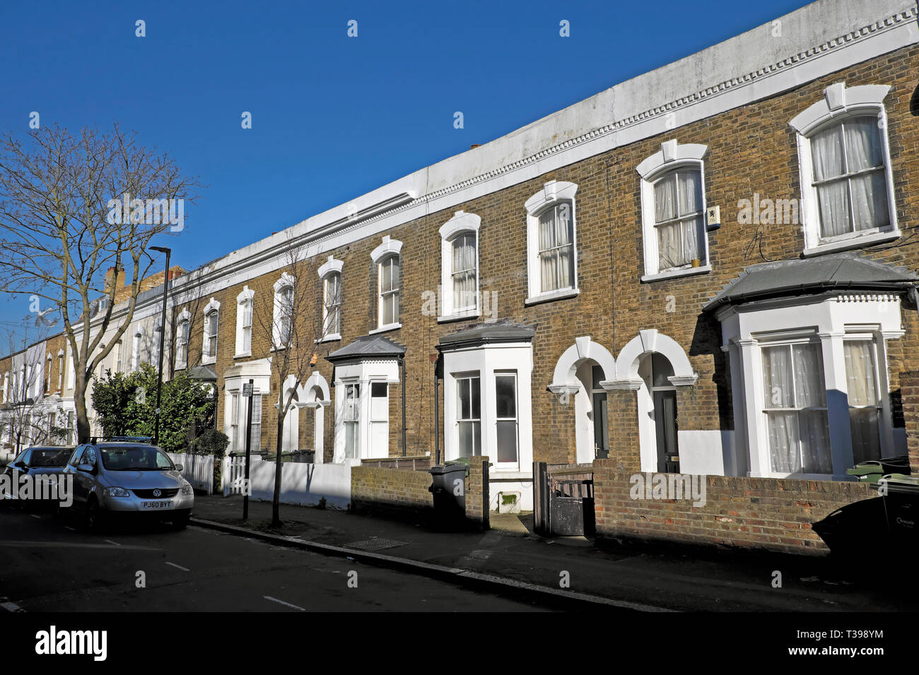 Row of terraced housing on Hargwyne Street in Brixton, South London SW9 England UK  KATHY DEWITT - Stock Image
