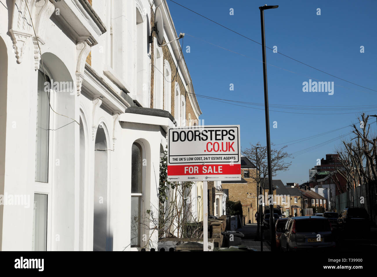 For sale sign outside a house in a row of terraced houses on Pulross Road in Brixton, South London SW9 England UK   KATHY DEWITT Stock Photo