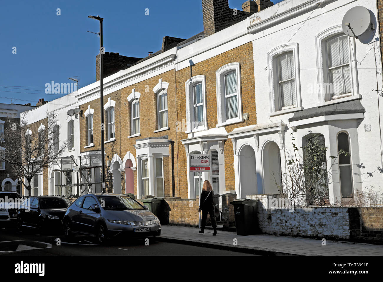 For sale sign outside a house in a row of terraced houses on Pulross Road in Brixton, South London SW9 England UK   KATHY DEWITT - Stock Image