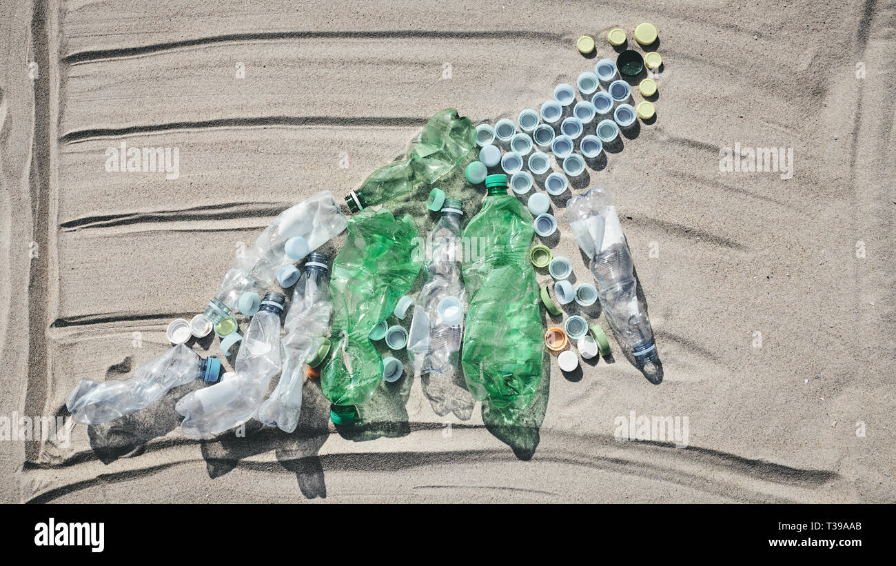Chart made of bottles and caps on sand showing the rise in single use plastic products found on European beaches, color toned picture. - Stock Image