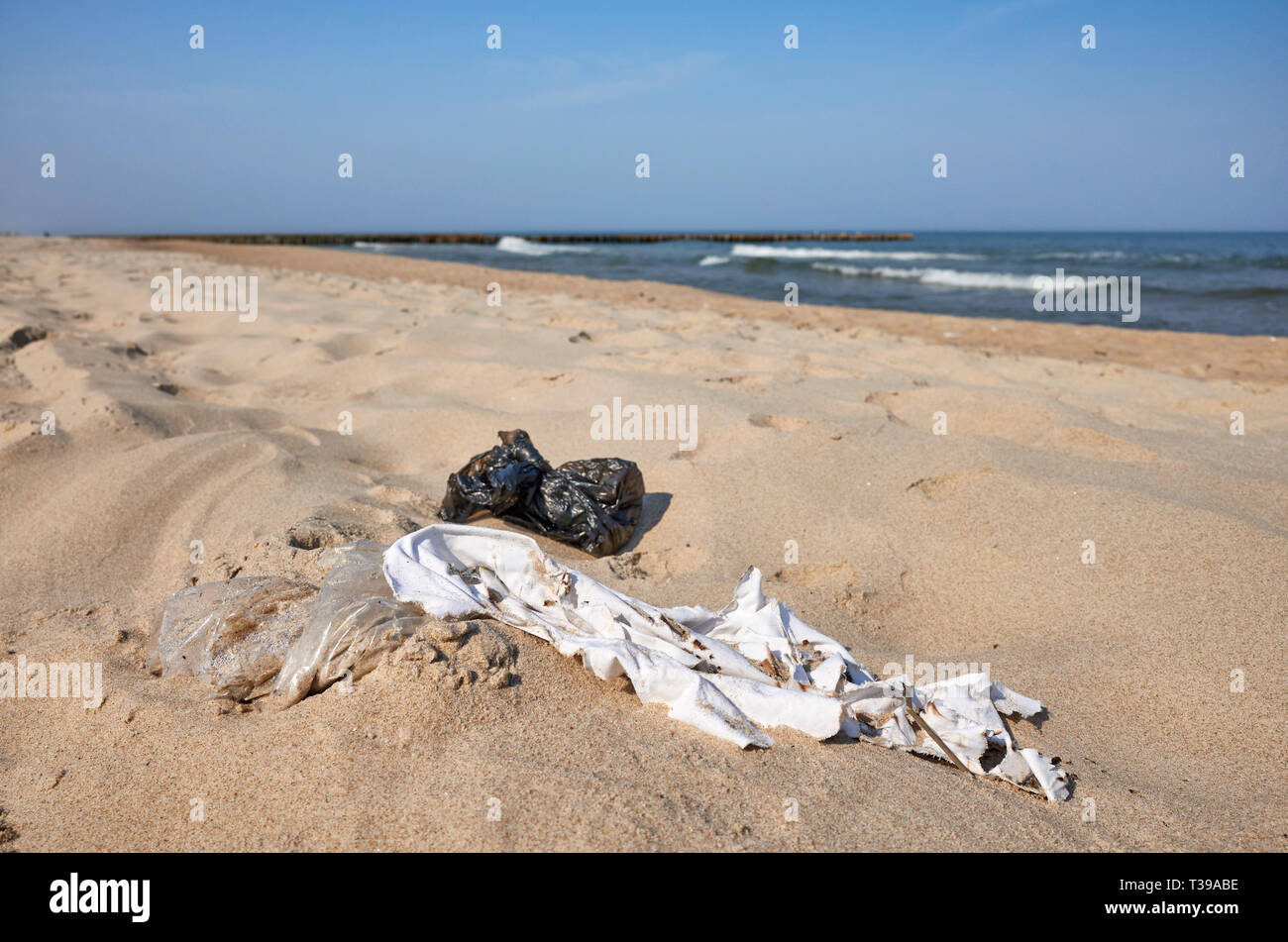 Garbage on a beach. On March 2019 The European Parliament has approved a law banning a wide range of single use plastic items by 2021. - Stock Image