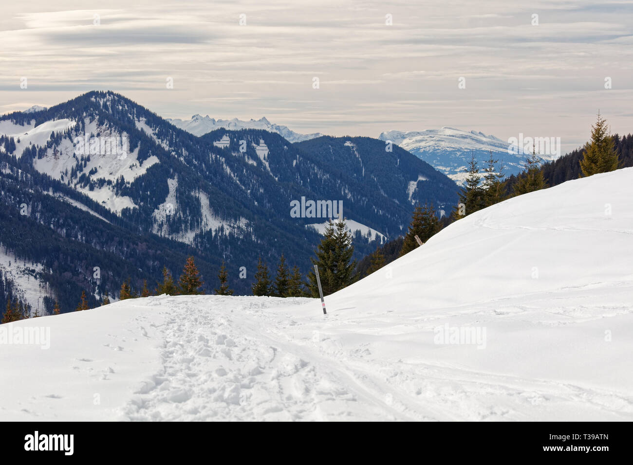 Views from snow covered Furkajoch alpine road with Laternsertal valley and Appenzell Alps in background - Vorarlberg, Austria - Stock Image
