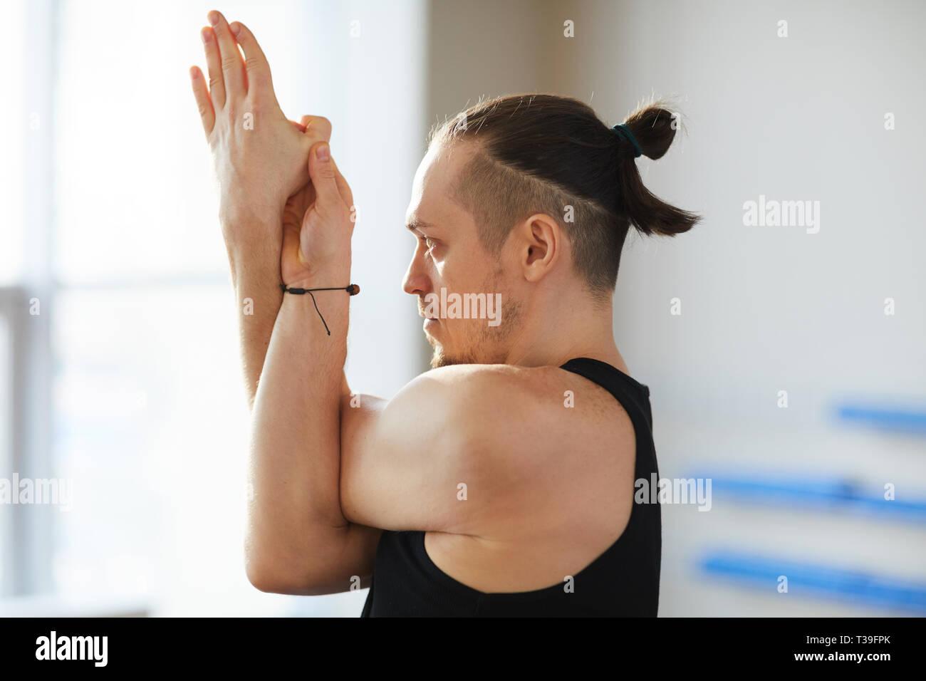 Yoga pose including eagle arms - Stock Image