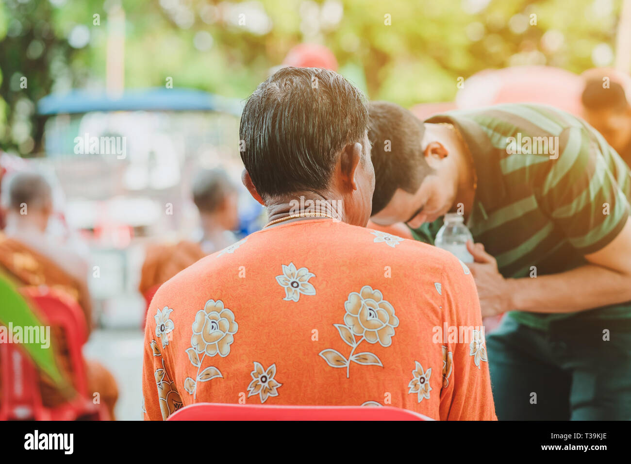 Thai people celebrate Songkran by pouring water and giving garlands to elder senior or respected grandparents and elder and asked for blessings for ce - Stock Image