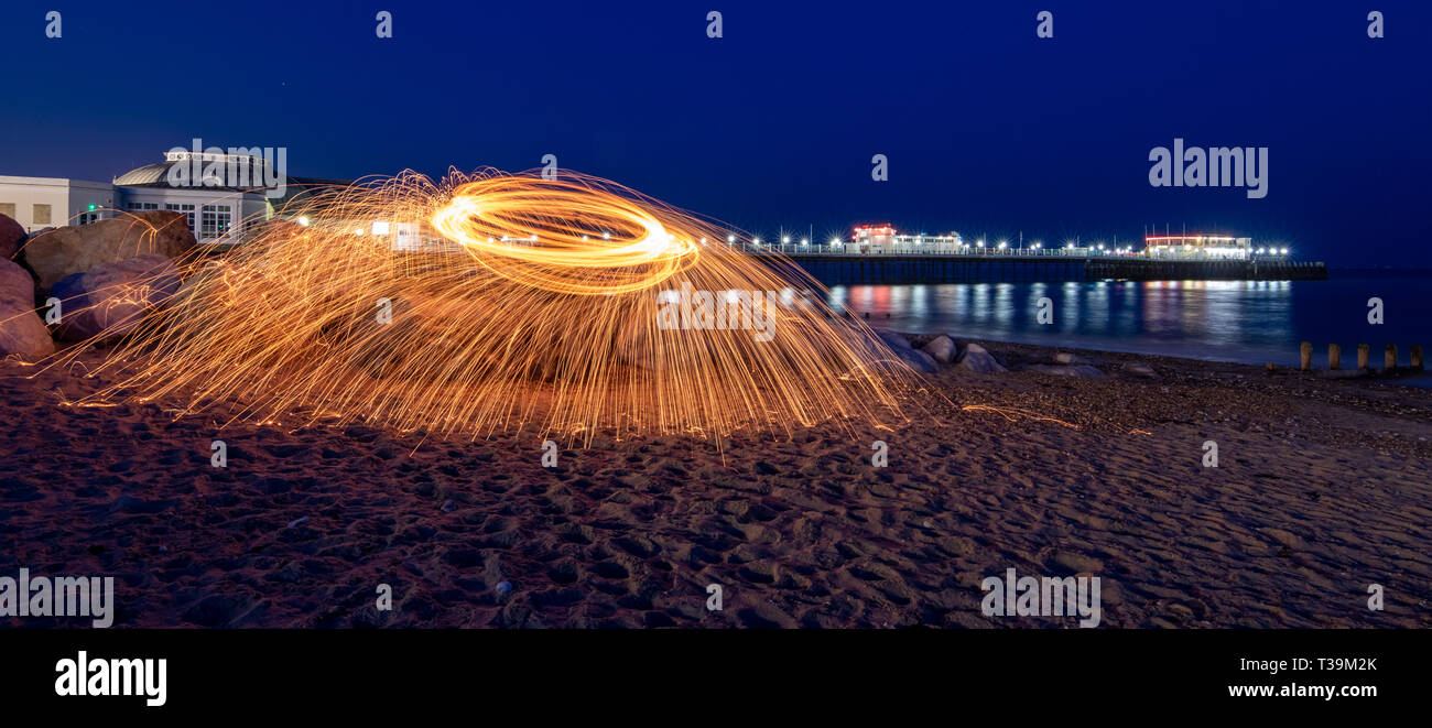 Wire wool spinning on the beach Stock Photo