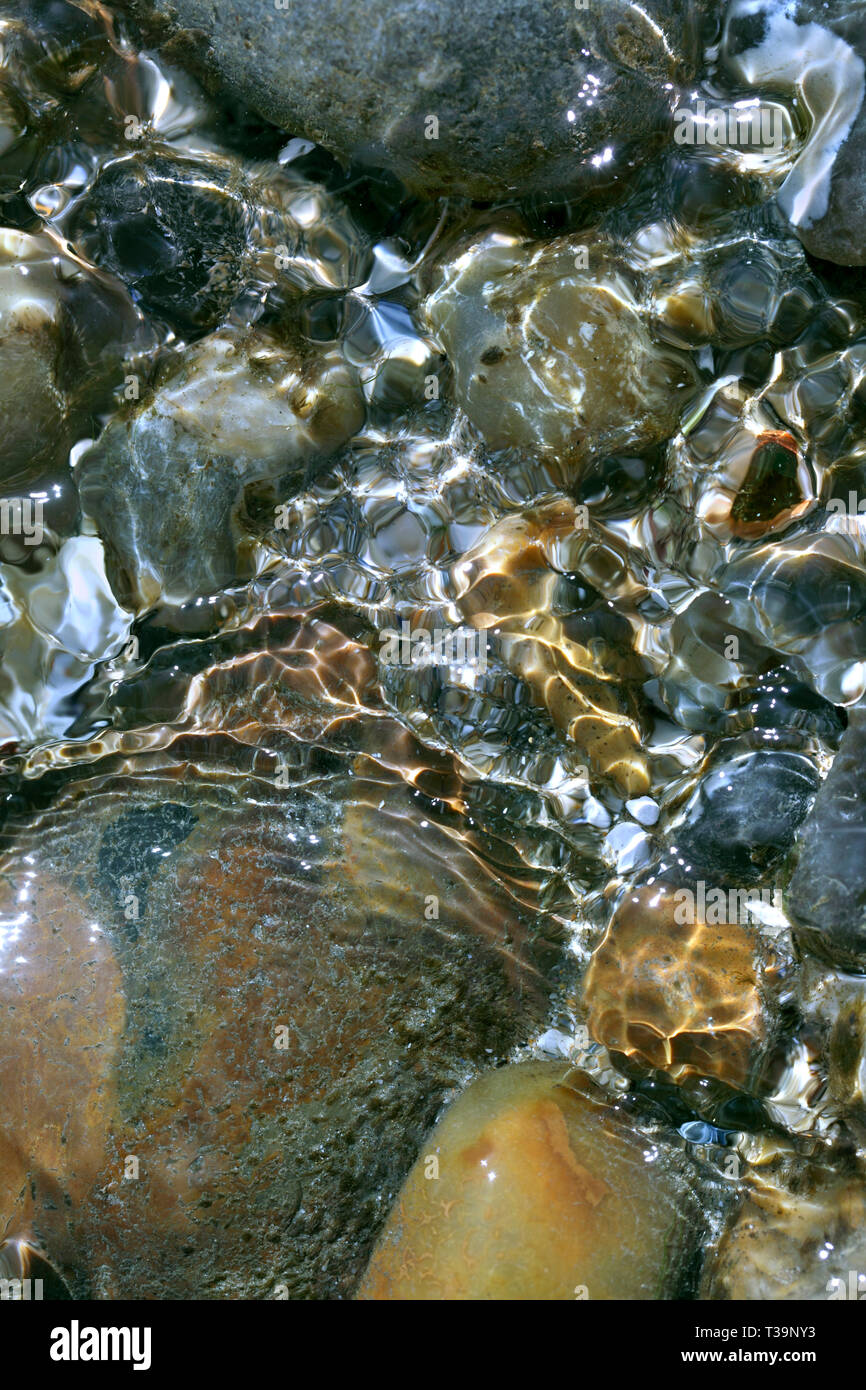 Close up of ripples of water in a rock pool on a beach, Brighton. - Stock Image