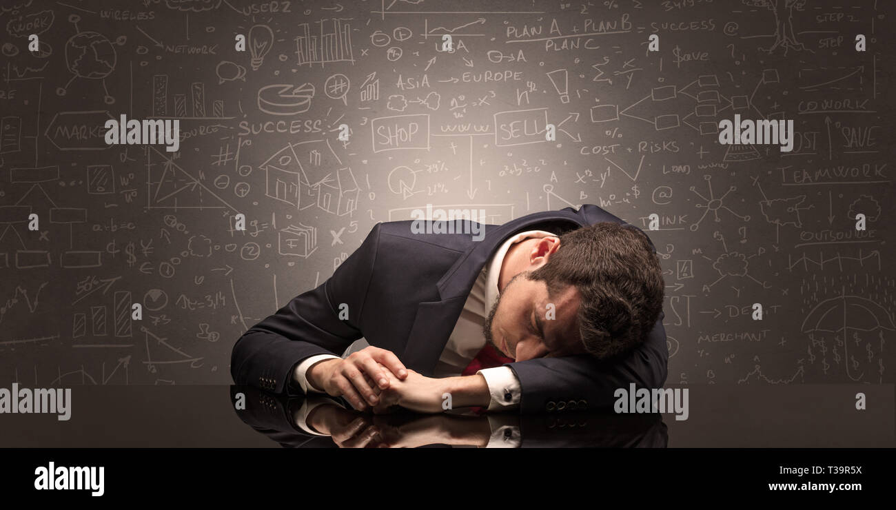 Elegant teacher fell asleep at his workplace with full draw blackboard concept  - Stock Image