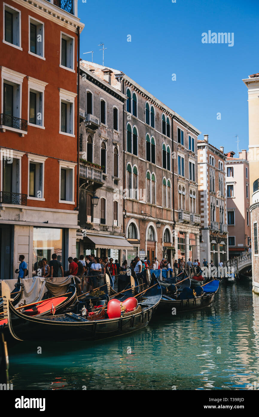 VENICE, ITALY - SEPTEMBER, 9 2018: Gondola Station Bacino Orseolo, overcrowded centre of Venice near to the St. Mark's Square, Piazza San Marco summer - Stock Image