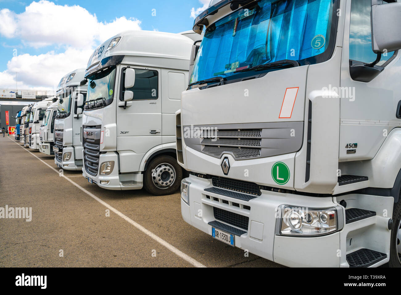 Valencia,Spain - March 30, 2019:  : Trailers parked in line. International shipping. Trucking and logistic. - Stock Image