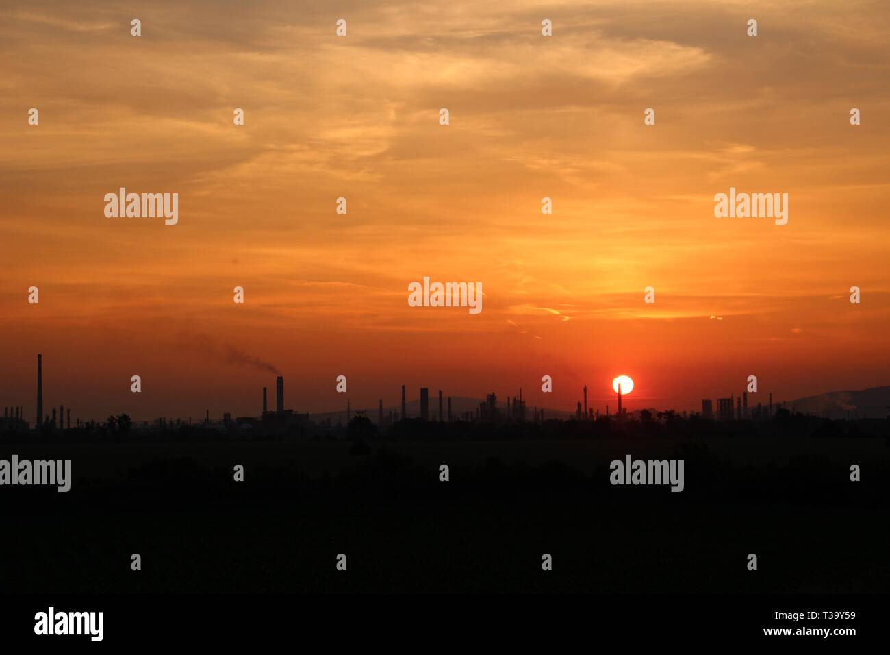 Oil rafinery during sunset - Stock Image